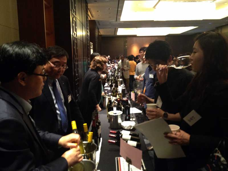 Mr. Lee, President/CEO of Nara Cellars pouring Esser Wines for consumers