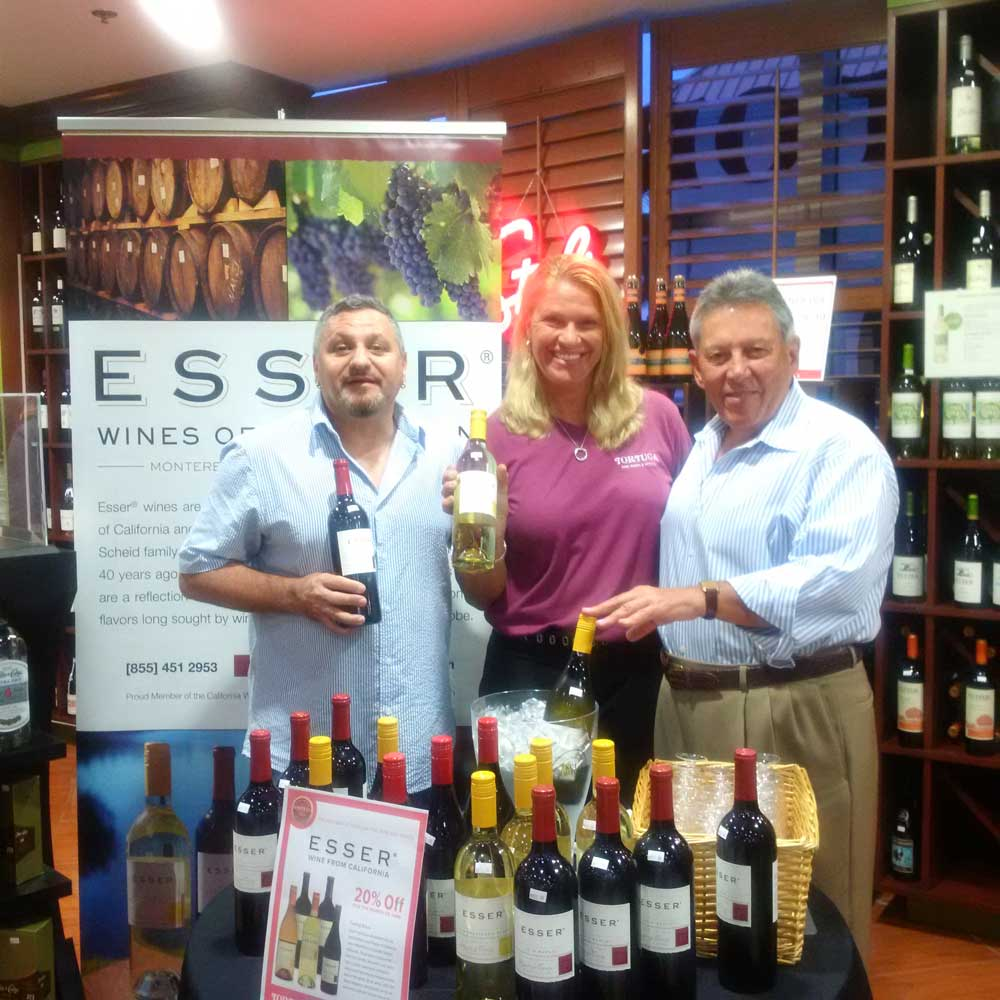 Max Consolini Wine Sales Mgr, Theresa Gregg, Retail Sales, and Earl Myers at the Governor's Square store